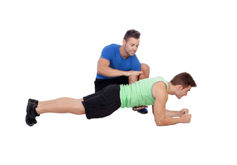 Personal trainer  and boy making push-ups
