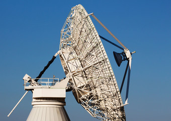 Radio telescope against the blue sky