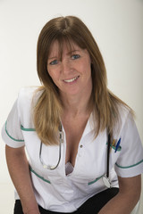 Woman in uniform holding stethoscope