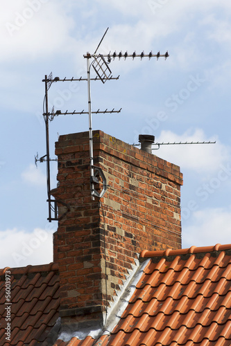 television aerial attached to an old chimney