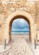 Archway leading to beach