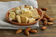 almond paste - marzipan in a bowl with whole nuts - 56005596