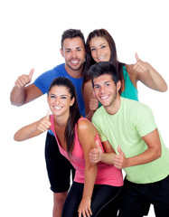 Group of friends with fitness clothes saying Ok