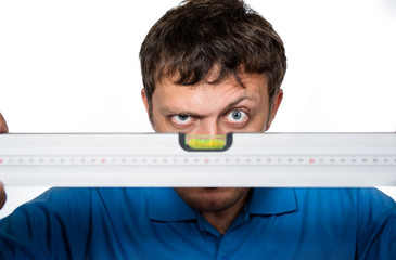 Man looks at the spirit level