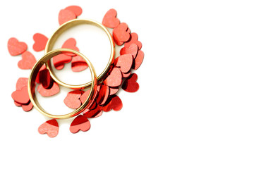 Gold rings with cute hearts and copy space