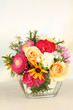 Beautiful bouquet of bright flowers in glass vase,