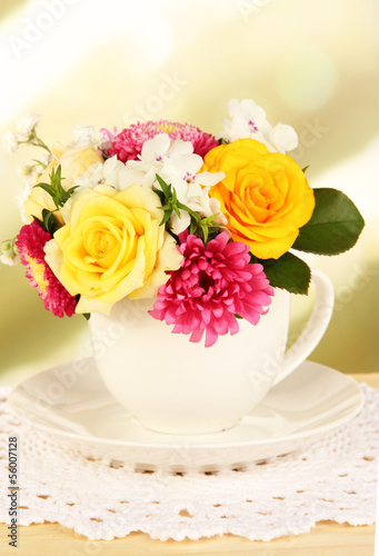 Beautiful bouquet of bright flowers in color mug,
