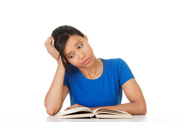 Woman studying at the desk being tired