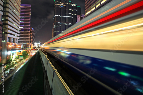 Motion of BTS sky train at night in Bangkok
