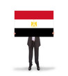 Businessman holding a big card, flag of Egypt
