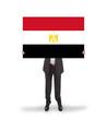 Businessman holding a big card, flag of Egypt