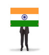 Businessman holding a big card, flag of India