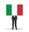 Businessman holding a big card, flag of Italy