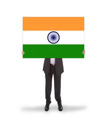 Businessman holding a big card, flag of India