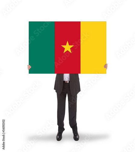Businessman holding a big card, flag of Cameroon