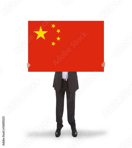 Businessman holding a big card, flag of China