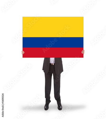 Businessman holding a big card, flag of Colombia