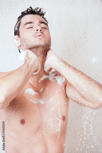 young handsome man in shower