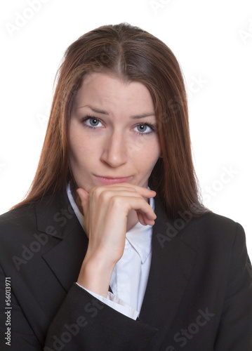 Thinking business woman with brunette hair