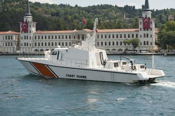 Coast Guard cutter on a river