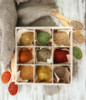 Assortment of spices in wooden spoons and box,