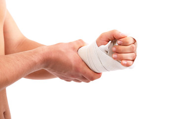 Young man with elastic bandage on hand, isolated on white