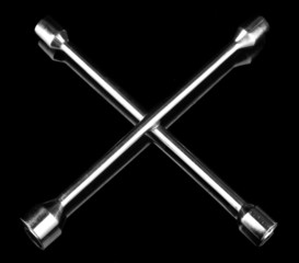 Wheel wrench on black background