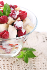 Fruit salad in glass bowl, isolated on white