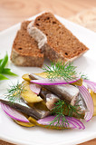 herring salad with pickled cucumbers and onions