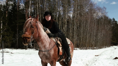 girl cowboy sitting on a horse