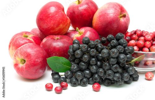 chokeberry, apples and cranberries close-up. white background.