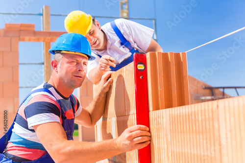 construction site workers checking  building shell