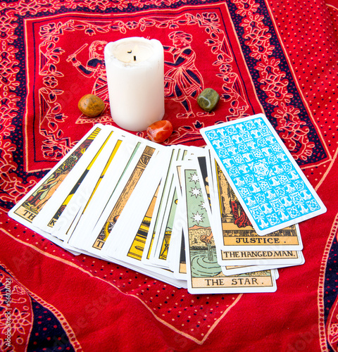Tarot cards and burning candle