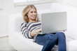 woman laying on the couch with laptop