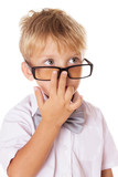 Boy adjusting glasses on nose