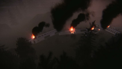 Aerial view of a large train derailment. Train cars on fire.