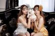 Two beautiful stylish girls with a rabbit