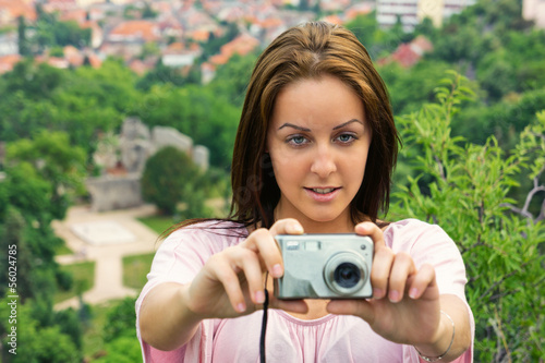 Beautiful young woman take a photo from a height