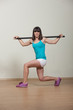 Attractive brunette woman doing fitness exercises for hands