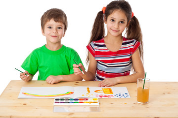 Two little kids drawing together