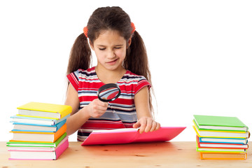Girl with books and magnifier