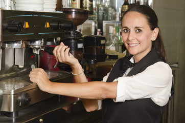 Pretty waitress preparing a coffee