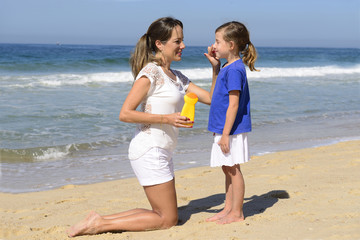 Mother applying sunscreen