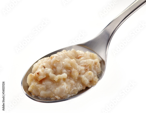 Spoon of oats porridge