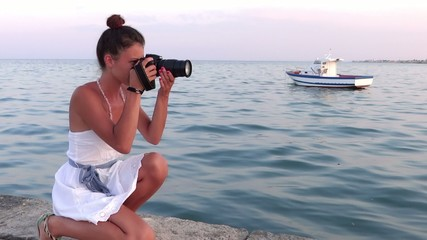 nice girl taking a photograph with her camera
