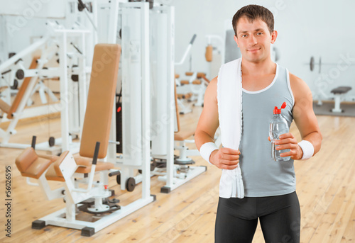 a sportsman with bottle and towel in gim