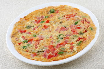 omelet with vegetables and tomato.