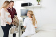 Doctor Looking At Expectant Couple In Clinic