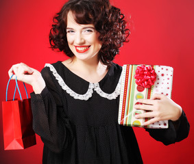 happy woman with shopping bag and gift.