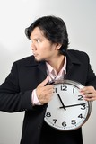 businessman stealing the clock